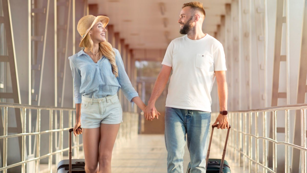 Couple travelers with suitcases | Travel Insurance - NADIC